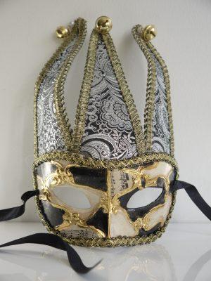 Dekorationsmask i guld och silver för inredning och dekoration