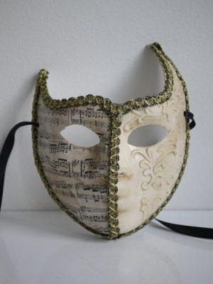 Krämfärgad prydnads-mask med noter
