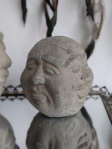 Buddha-huvud med fyra ansikten