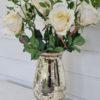 Konstgjord ros på stjälk. Besök Blickfång.se