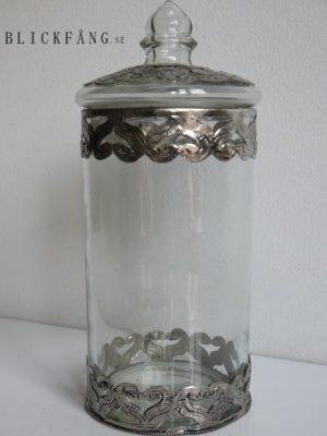Rund glasburk med lock dekorerad med silvermönster