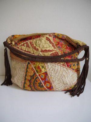 Stor gul väska med mönster i tyg