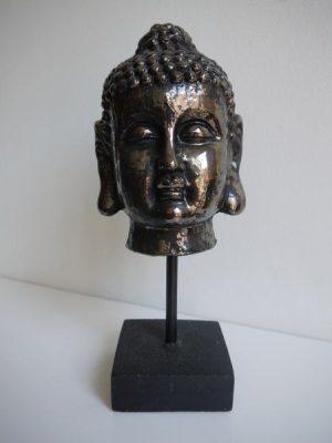 Rustik buddha ansikte på fot som prydnad