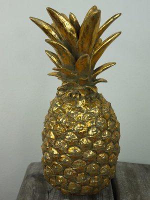 Ananas prydnad i guld för dekoration