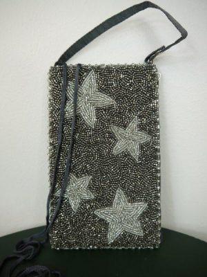 Liten pärlväska i silver med stjärnor