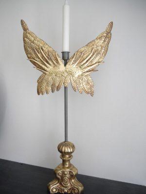 Ljusstake i guld med änglavingar