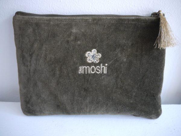 Liten grön väska med blad i guld