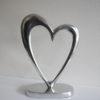 Hjärta i silver på fot. Besök Blickfång.se