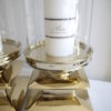 Stor-ljuslykta-i-guld-med-clascylinder-1