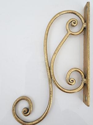 Väggkrok i guld. Besök Blickfång.se