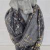 gra-scarf-med-monster-i-guld-och-silver