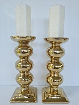 Blockljusstake par i guld. Besök Blickfång.se
